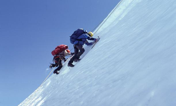 A pair of Calvert's fellow climbers on the side of Kilimanjaro.