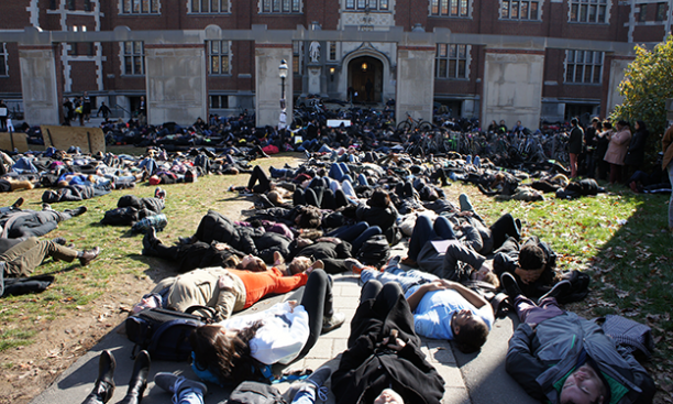 """Protesters blocked the paths outside Frist in a symbolic """"die-in."""""""