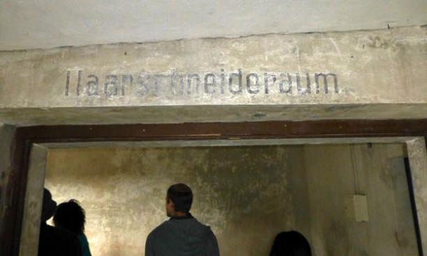 At Birkenau, Eric Silberman '13 examines the barbering room.