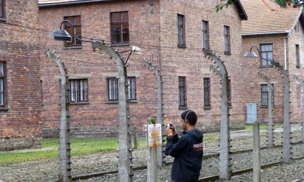 Quintin Sally '14 takes pictures at the Auschwitz concentration camp.