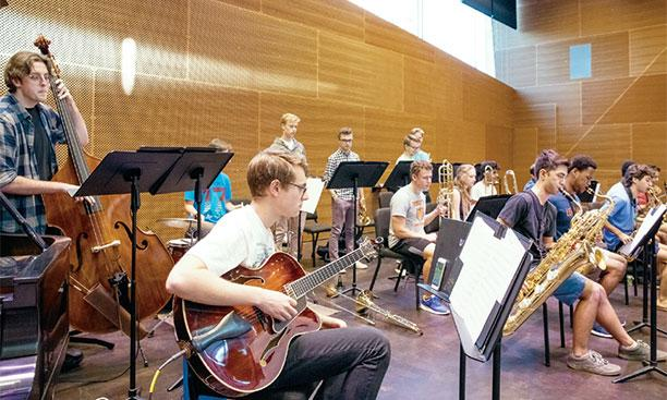 The Princeton University Jazz Ensemble practices in the Lee Music Performance and Rehearsal Room. Denise Applewhite
