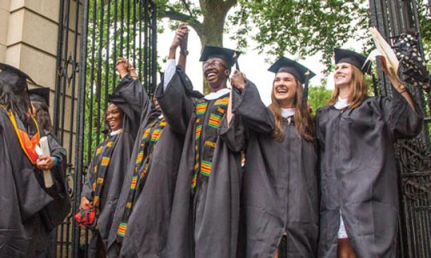 Graduates from the Great Class of 2015 rejoice as they exit campus through FitzRandolph Gate.