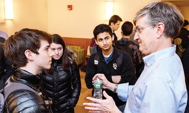 Ed Felten, director of Princeton's Center for Information Technology Policy, talks with studentsSameer A. Khan/Fotobuddy