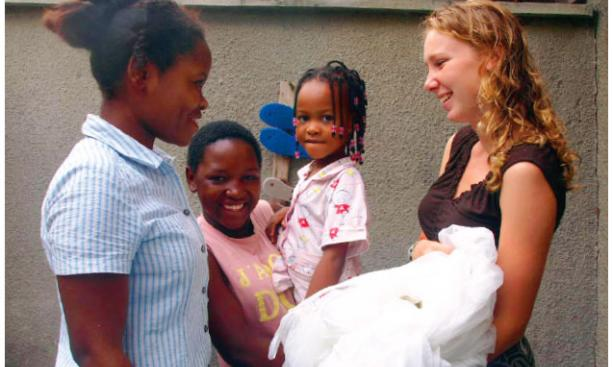 Recent graduates like Kimberly Bonner '08, pictured here in Tanzania distributing bed nets to combat malaria, have often engaged in international public service. Now our incoming freshmen will have a chance to do so, too.