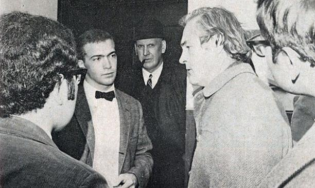 "Proctor ""Axel"" Peterson, with pipe, looks on as students interview Dr. Timothy Leary. (George Peterson '69/PAW Archives)"