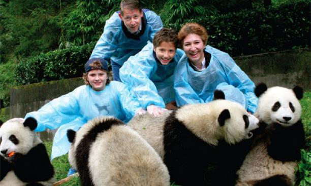 Dean Slaughter, Professor Moravcsik, and their children, Edward (left) and Alexander, at the Wolong Panda Reserve—the largest in China.