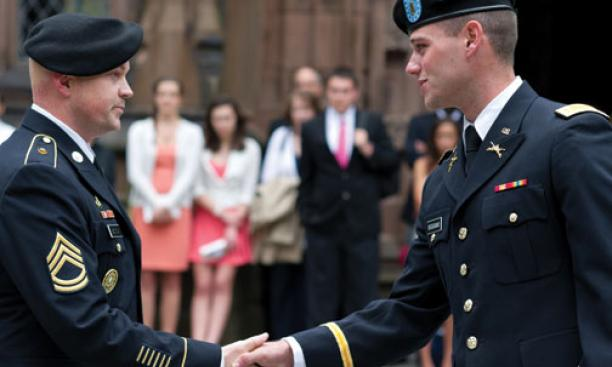 Thomas Boggiano '12 gets a handshake from Sgt. 1st Class Gregory Bentow after receiving his first salute as an officer.