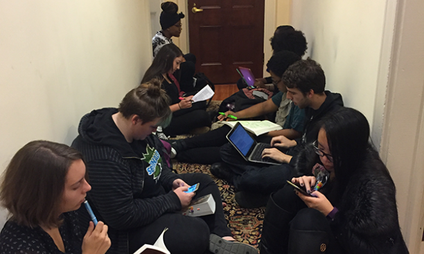 On Wednesday afternoon, the sit-in spilled into the hallway outside President Eisgruber '83's office. (Mary Hui '17)