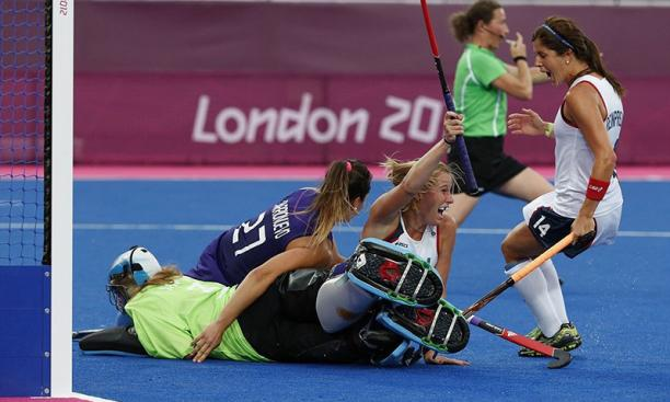 July 31: Katie Reinprecht '13, right, celebrates a goal by U.S. field hockey teammate Shannon Taylor during the Americans' win over Argentina. It was Team USA's only victory in London; Argentina went on earn claim silver.
