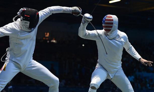 Aug. 1: Returning to the Olympics after an eight-year absence, Soren Thompson '05, right, lost his opening match to Germany's Joerg Fiedler in the single-elimination men's individual epee draw.