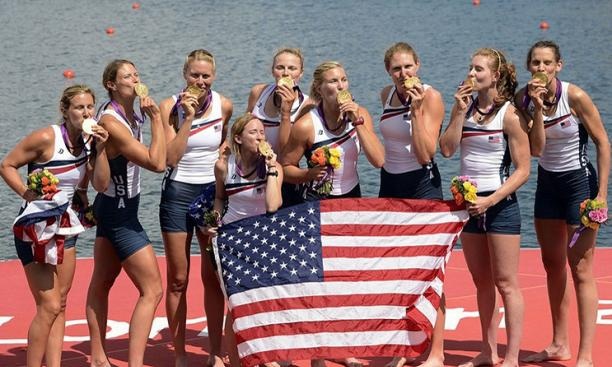 Aug. 2: For Caroline Lind '06, second from right, a second trip to the Olympics meant a second gold medal with the U.S. women's eight. Canadian rowers Andreanne Morin '06 and Lauren Wilkinson '11 earned silver in the same event.