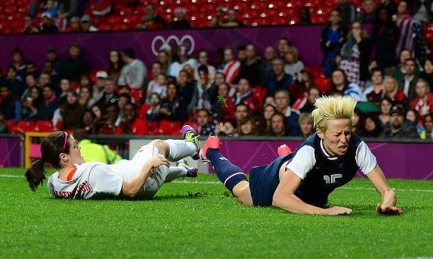 Aug. 6: Canada's Diana Matheson '08, left, and Megan Rapinoe of the United States collide in the women's soccer semifinals. Canada lost in overtime but recovered to win bronze against France on Matheson's 92nd-minute goal.