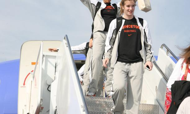 Sophomore Mariah Smith gives a Nixon-esque salute as the Tigers exit the plane in Texas.