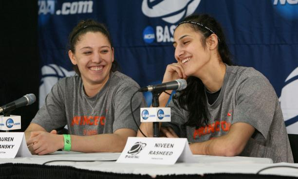 Longtime friends Lauren Polansky '13, left, and Niveen Rasheed '13 share a light moment at the March 23 pregame press conference.
