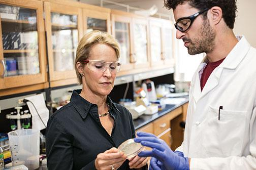 Arnold with postdoc Christopher Prier *14 in her lab.