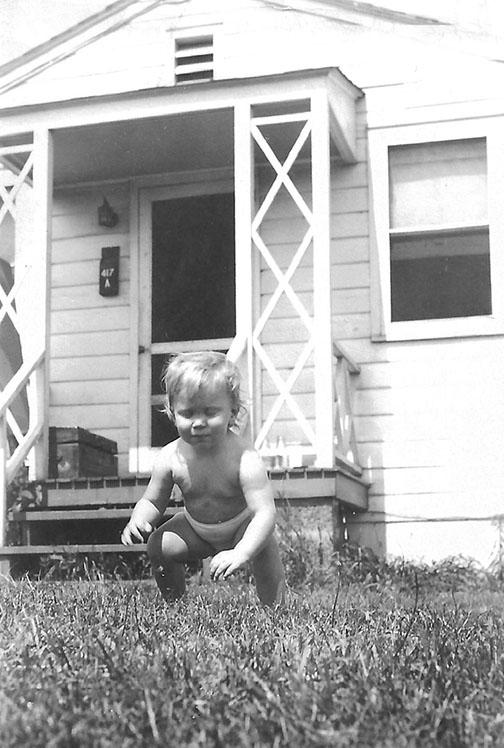 G. William Goward *54's daughter, Beverly, explores the family's front lawn at 417A Butler Ave.