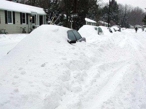 Many residents told stories of snow and cold weather. A storm buried cars in February 2003.