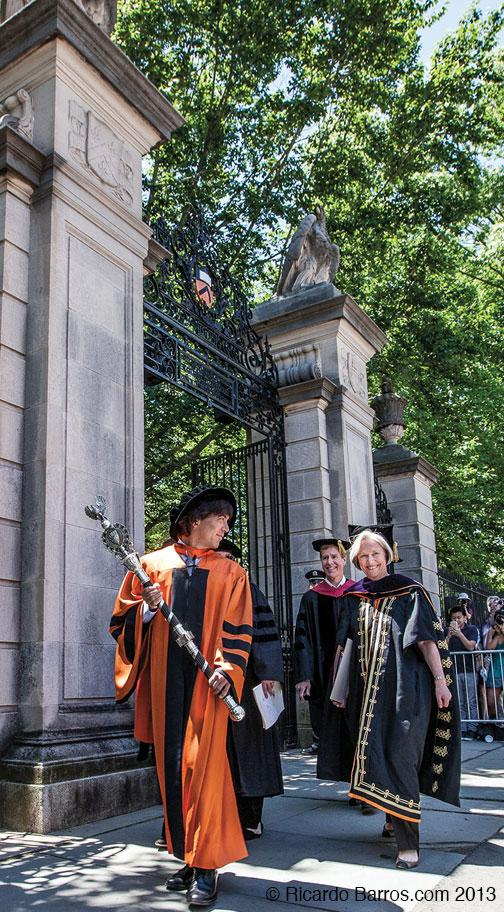 Last march: Mace-bearing Professor Jeff Nunokawa and President Tilghman exit after Commencement through FitzRandolph Gate.