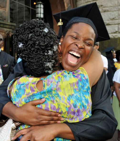 Cecelia Ogechi Oparah '13 hugs a roommate's mother at the Pan-African ceremony June 2.