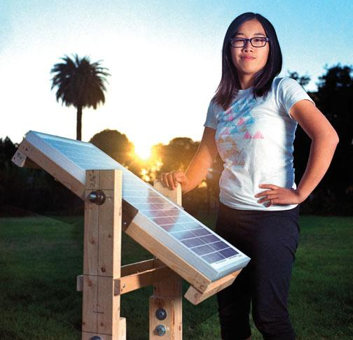 Eden Full '15 displays a prototype of the SunSaluter in Oakland, Calif., in 2012.