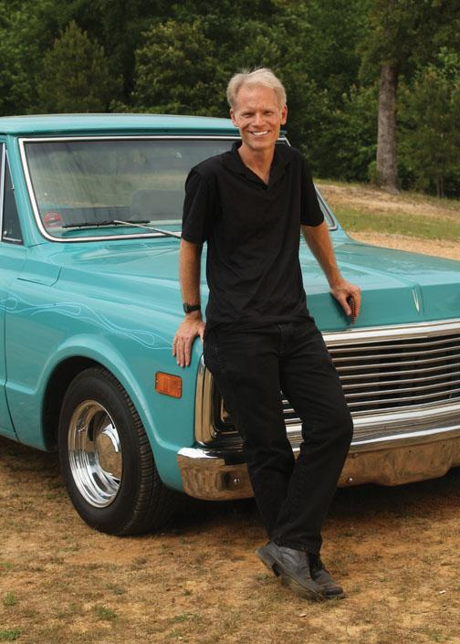 """Gussow with his """"automotive toy,"""" a 1972 Chevy Cheyenne that he bought in 2009 and souped up. It's """"quite a rumble when you fire her up,"""" he says. """"Living in Manhattan for 22 years, I could never indulge my passion."""""""