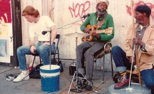 Gussow plays with Magee, center, and Bobby Bennett on 125th Street in Harlem in 1986.