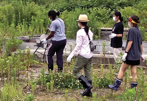 Princeton students search for personal effects among the foundations of homes swept away by the tsunami near Otsuchi Bay in Kamaishi.