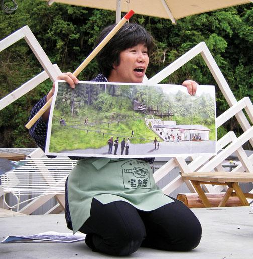 Inn owner Akiko Iwasaki describes her plans to replace a tsunami evacuation path with a broad stairway for outdoor performances.