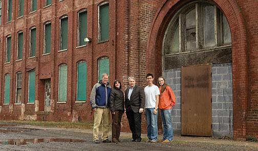 "Johnson with Princeton engineering students and visiting lecturer Robert Harris in 2008. The students were helping to transform the former textile mill into what's planned as the core of a ""sustainable urban village."""