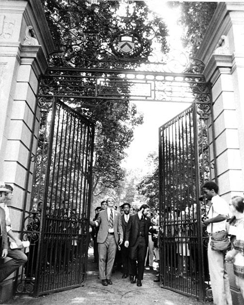 Class president Stewart Dill (now McBride), left, Hal Strelnick '70, and Michael Calhoun '70, behind, lead graduates through FitzRandolph Gate after their Commencement. Most seniors skipped the traditional Commencement gowns and wore armbands sym
