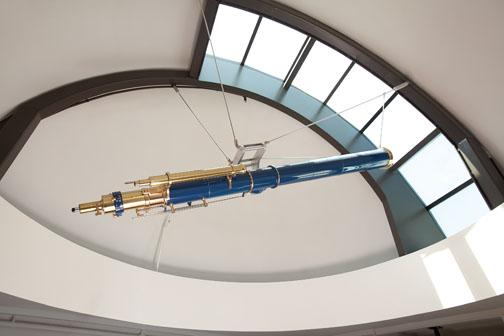 This refurbished 1877 Alvan Clark telescope is believed to have been used by Professor Charles Young in his teaching. It now hangs in the ­conference room in Peyton Hall.