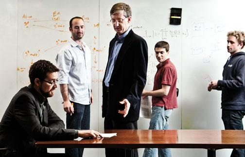 Schultze and Felten ­discuss a problem with graduate students, from left, William Clarkson, Joseph Calandrino, and William Zeller.