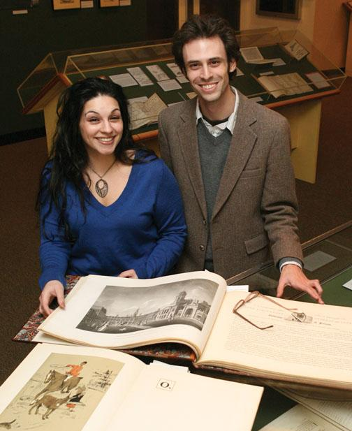 Renée Fox *10 and Gregory Londe GS display two volumes included in a Firestone Library exhibition that tells the story of Irish prose. The two curated the exhibition.