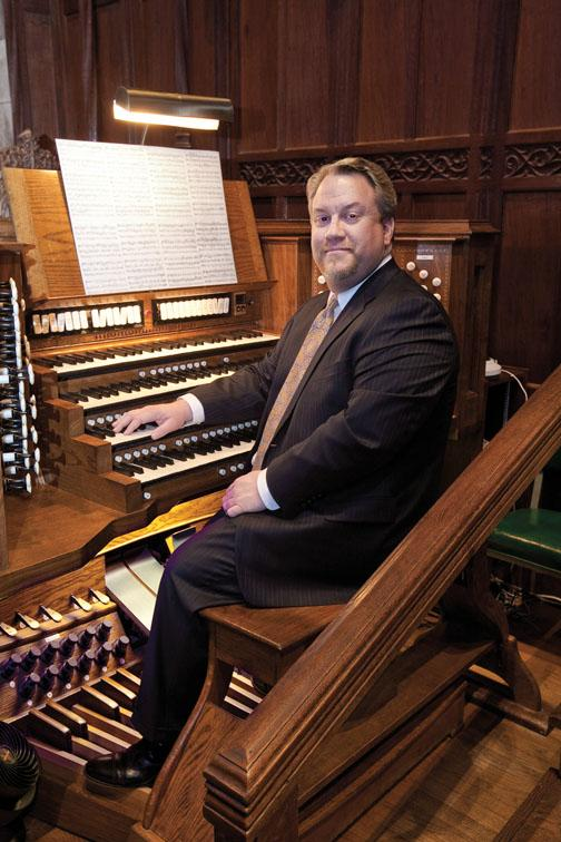 "Even when the Chapel is full, playing the organ is a ""very solitary"" experience, says organist Eric Plutz, above. In the Chapel, Plutz sits up front, beneath the chandelier. ""People don't know I'm up there. I feel a little bit like the Wizard of"