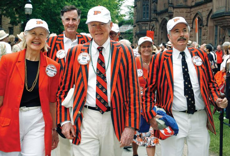 Sporting the colors and stripes of the Class of 1958 are, from left, Marianne and Jim Farrin, and Robin Ledwith, with Tony Tully and Ginny Meloy s'58 following behind.
