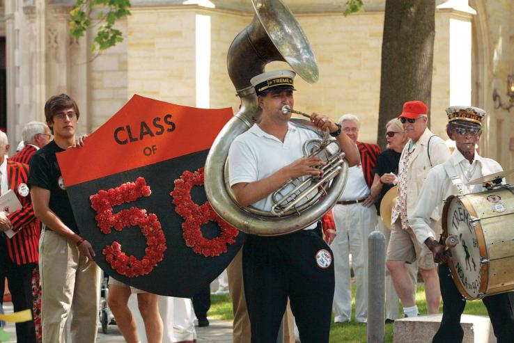 New Orleans' Treme Brass Band leads the Class of 1958's memorial procession