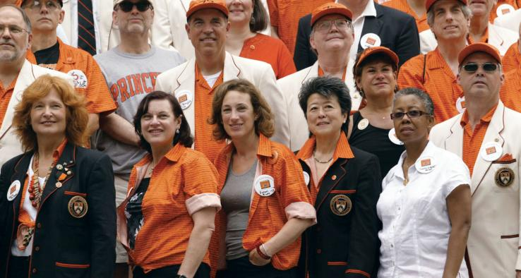 From left, Marta Richards, Pamela Karr Harrison, Susan Blatt Schwab, Helen Zia, Tonna Gilbert Rose, and Mike Coccaro take the front row as the Class of 1973 — the first four-year coed class — poses for its photo.