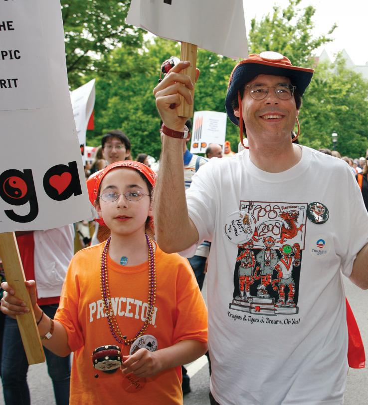 Matt Blumrich *96 marches with his daughter, Sarah.