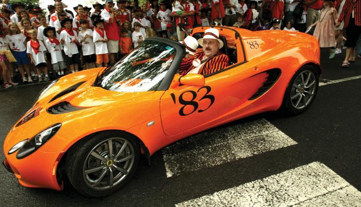 Sev Onyshkevych '83 drives his Princeton-themed orange Lotus in the P-rade.