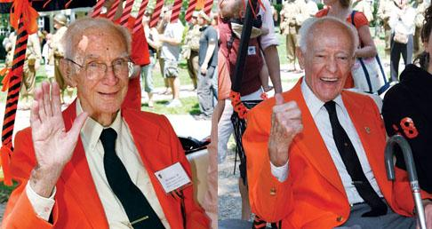 Jack Bales '34, left, and Bill Selden '34 acknowledge cheers along the P-rade route.