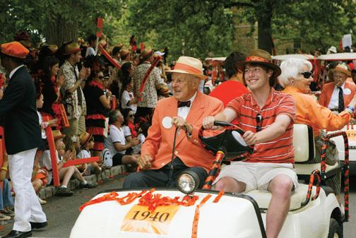Bill Kelley '40, driven by Andy Linz '11, accepts applause along the P-rade route.