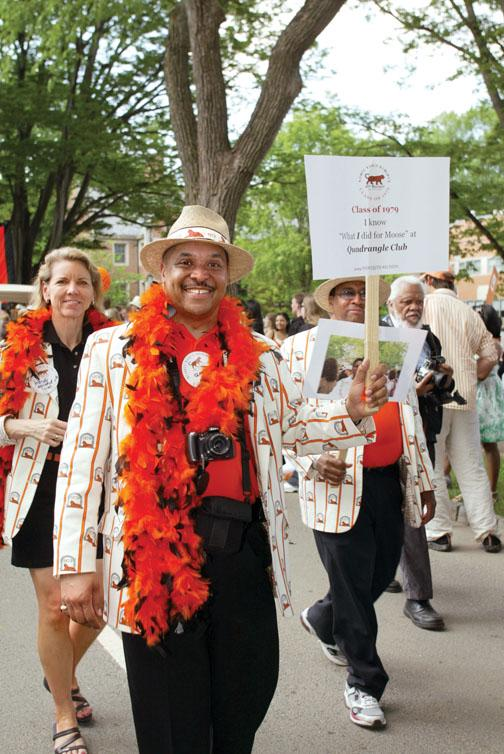 Gary M. King '79, center, and Wendy Weisend Kuran '79 and Prentis Hall '79 show their stripes as they march in the P-rade accompanied by music of the 1970s.