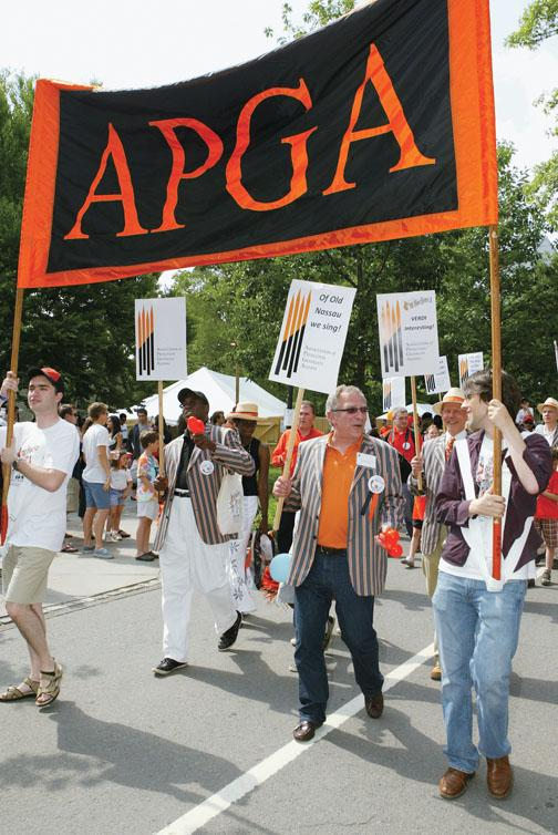"""With a bluegrass band, graduate alumni march to """"PrinceTunes"""" in the P-rade."""