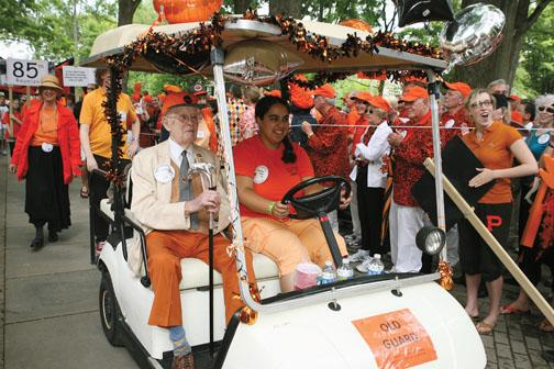 Malcolm Warnock '25 carries the Class of 1923 cane – for the sixth time. His driver is Ariana Vera '12.
