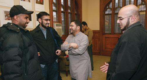 Chaplain Sohaib Sultan, third from left, talks with students after the weekly prayer service, which is held in a room in Murray-Dodge Hall that is set aside for Muslim prayer.