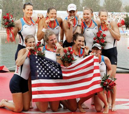 Caroline Lind '06, standing second from right, celebrates with members of the U.S. women's eight after the team won the gold medal at the Beijing Olympics Aug. 17.