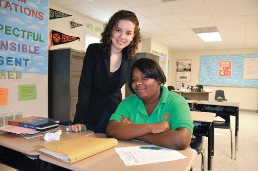 Jeylan Erman '08, left, with a student at Carver High School in New Orleans.
