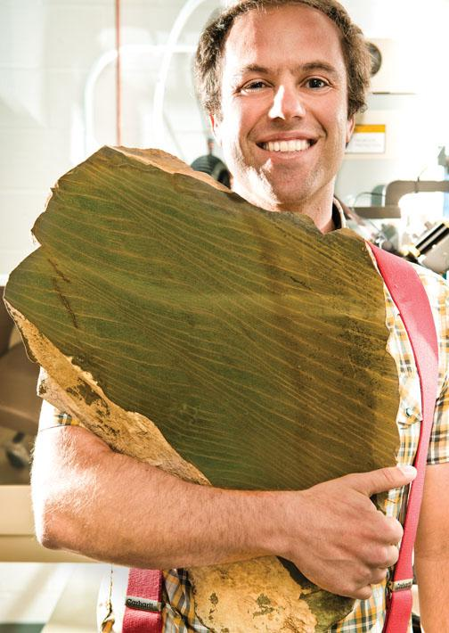 Adam Maloof prepares to grind a rock that records tidal cycles 640 million years ago.