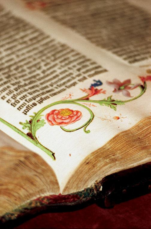 "A close-up photograph in ""Biblio"" captures the vivid colors of the illustrations in the 1455 Gutenberg Bible."