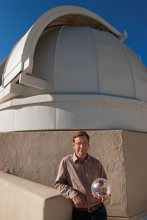 Mike Brown '87 holds his lunar rover on the roof of Caltech's historic solar observatory.